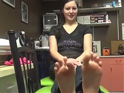Brunette girl takes off her socks to show these pretty feet