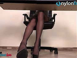 Secretary in pantyhose – foot fetish and shoe play under her desk